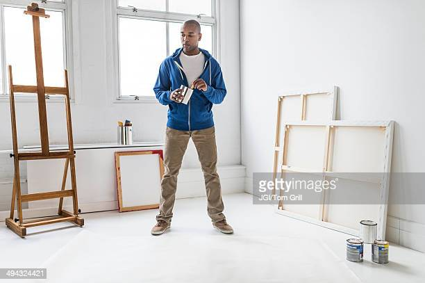 Black artist standing in studio