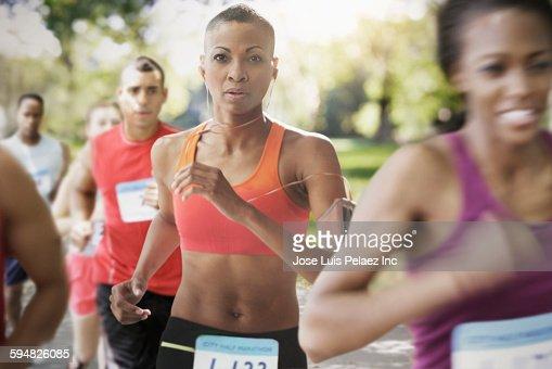 Black athlete running in race