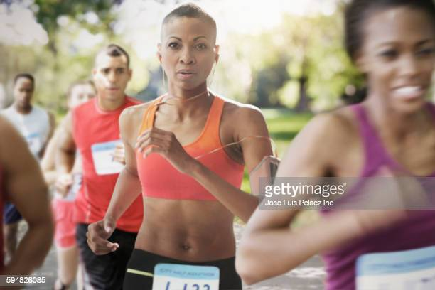 Black athlete running in race