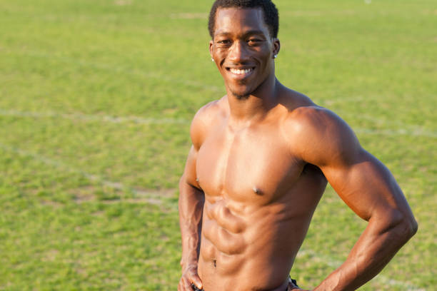 Black athlete smiling on sports field