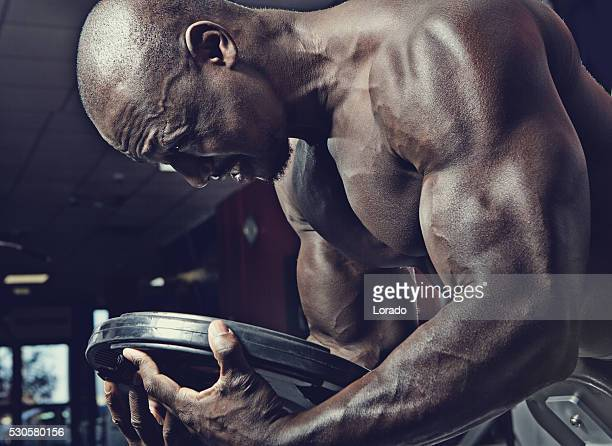 black athlete working out at a gym