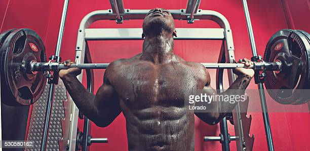 black athlete working out at a gym - black male bodybuilders stock photos and pictures