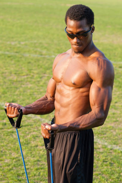 Black athlete working out on sports field