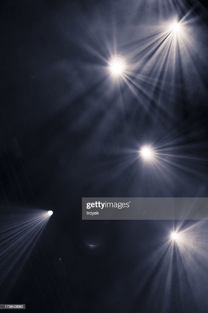 Black background with five scattered spotlights : Stock Photo