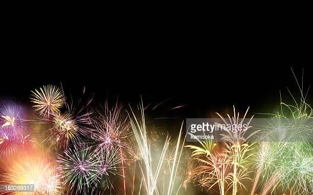 Black background with multi colored fireworks exploding