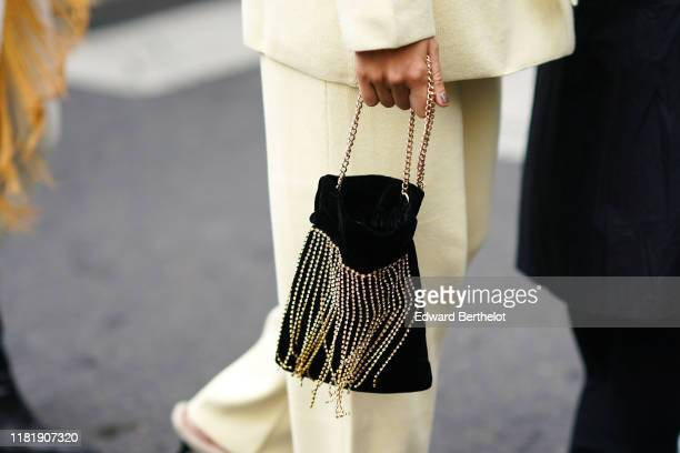 A black bag with bejewelled fringes is seen outside Thom Browne during Paris Fashion Week Womenswear Spring Summer 2020 on September 29 2019 in Paris...