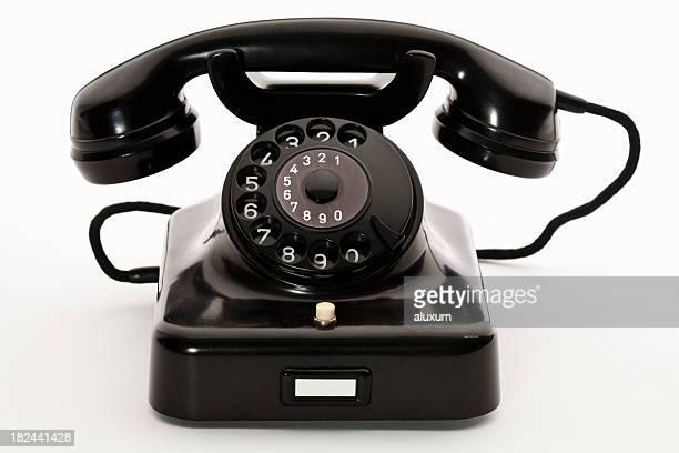 Black bakelite classic rotary phone isolated on white
