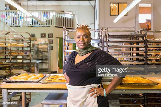 Black baker standing in bakery kitchen