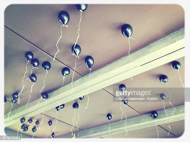 Black balloons stuck to the ceiling