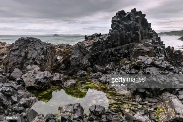 Black basalt rock by the sea, Blackhead, Dunedin, Otago, Southland, New Zealand