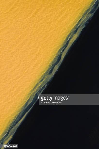 Black beach and unusual coloured water, southern region of Iceland - Diagonal