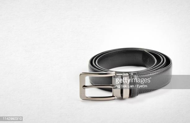 black belt on white background - belt stock pictures, royalty-free photos & images