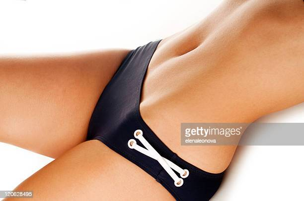 Black bikini bottom with white lace on woman's body