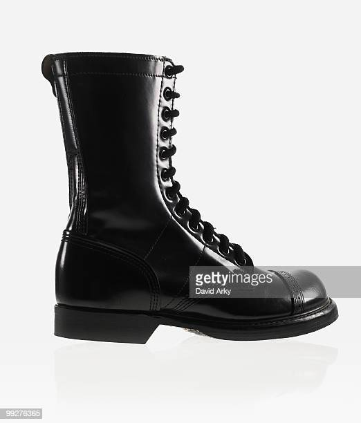 black boot - black boot stock pictures, royalty-free photos & images