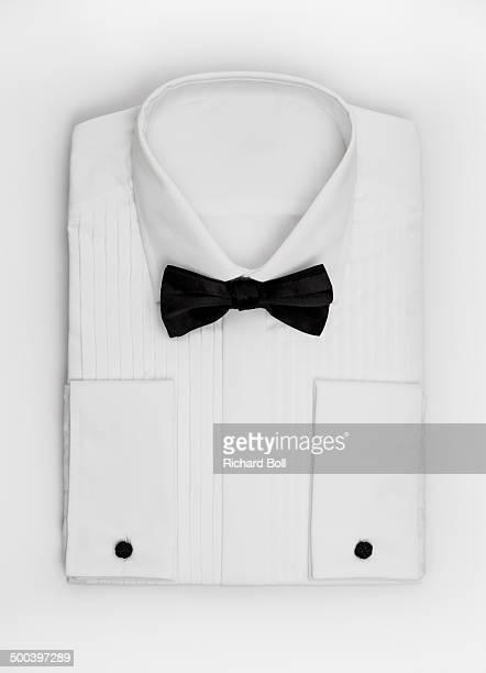 Black bow tie on a white dress shirt
