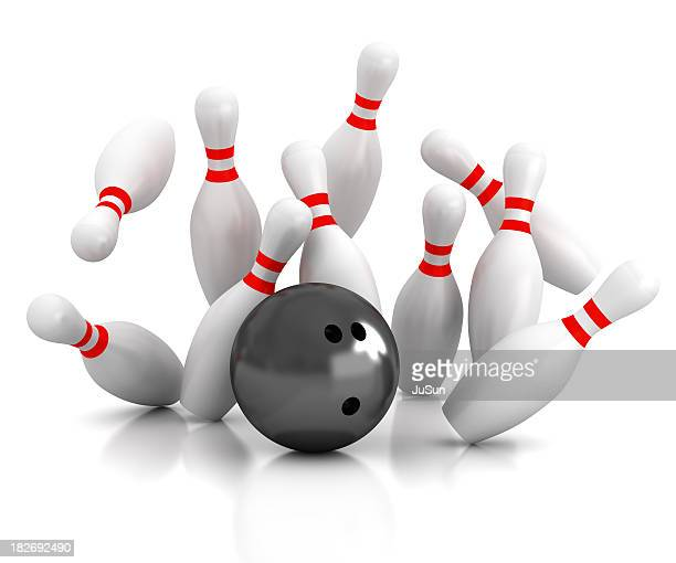 Black bowling ball striking bowling pins