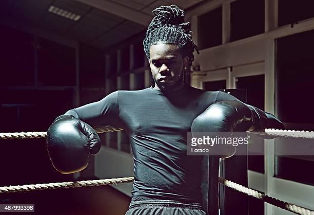 black boxer relaxing in the boxing ring corner - boxing gloves bildbanksfoton och bilder