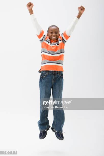 Black boy cheering and jumping