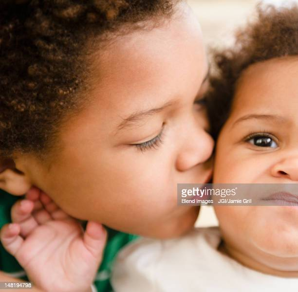 Black boy kissing sister