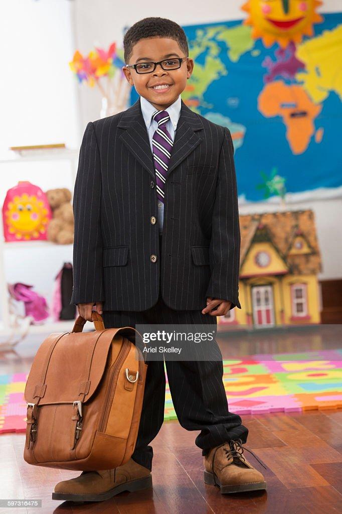Black boy wearing businessman costume : Stock Photo