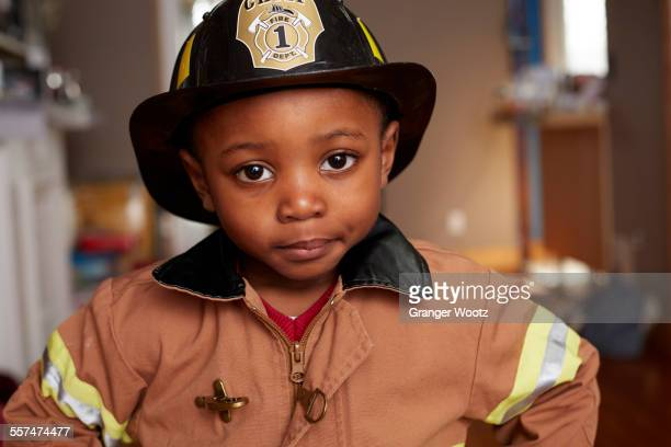 Black boy wearing firefighter Halloween costume