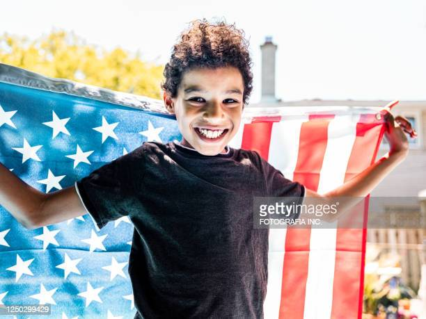 black boy with american flag - social movement stock pictures, royalty-free photos & images