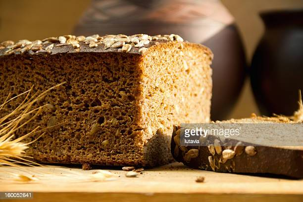 black bread with sunflower seeds - lutavia stock pictures, royalty-free photos & images