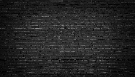 black brick wall background. texture dark masonry 915097804