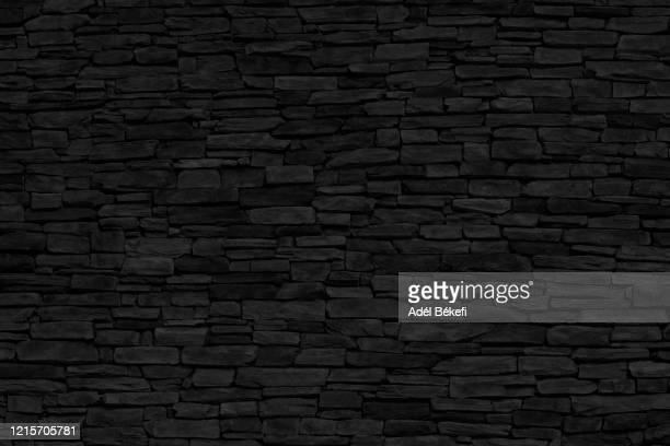 black brick wall - black colour stock pictures, royalty-free photos & images