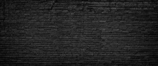 black brick wall, texture of dark brickwork close-up 1129029770