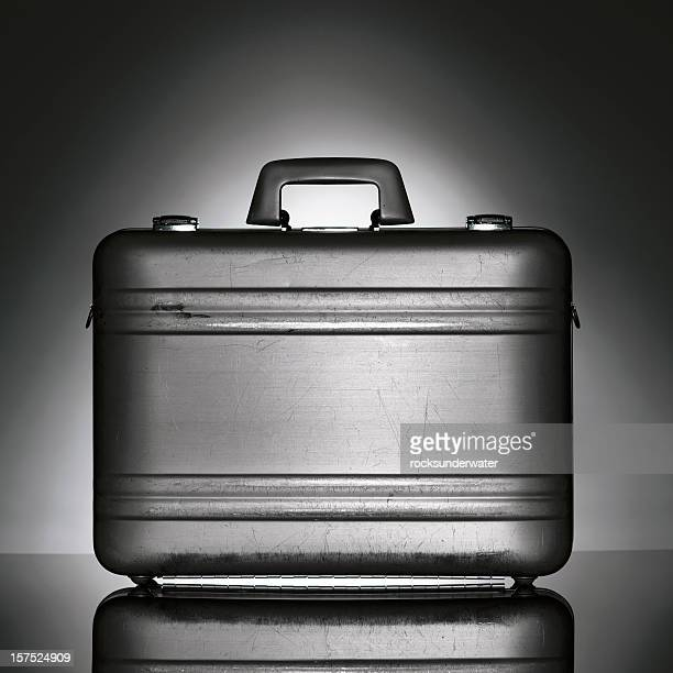 black brief case isolated on a abstract background - briefcase stock photos and pictures