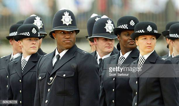 A black British police officer stands to attention during the Metropoitan Police Service's 175th Anniversary service on June 4 2004 in London England...