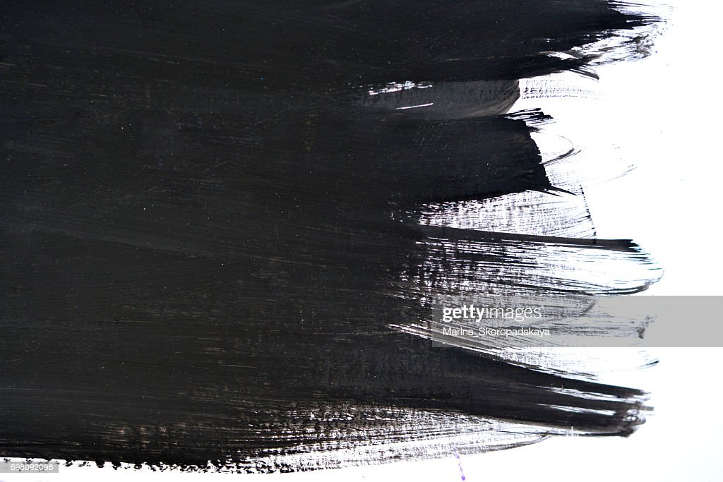 black brush strokes on white paper