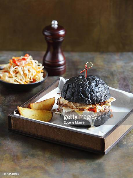 Black burger with beef