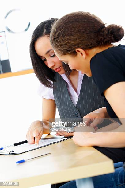 Black Business Mentor talking to client in modern office