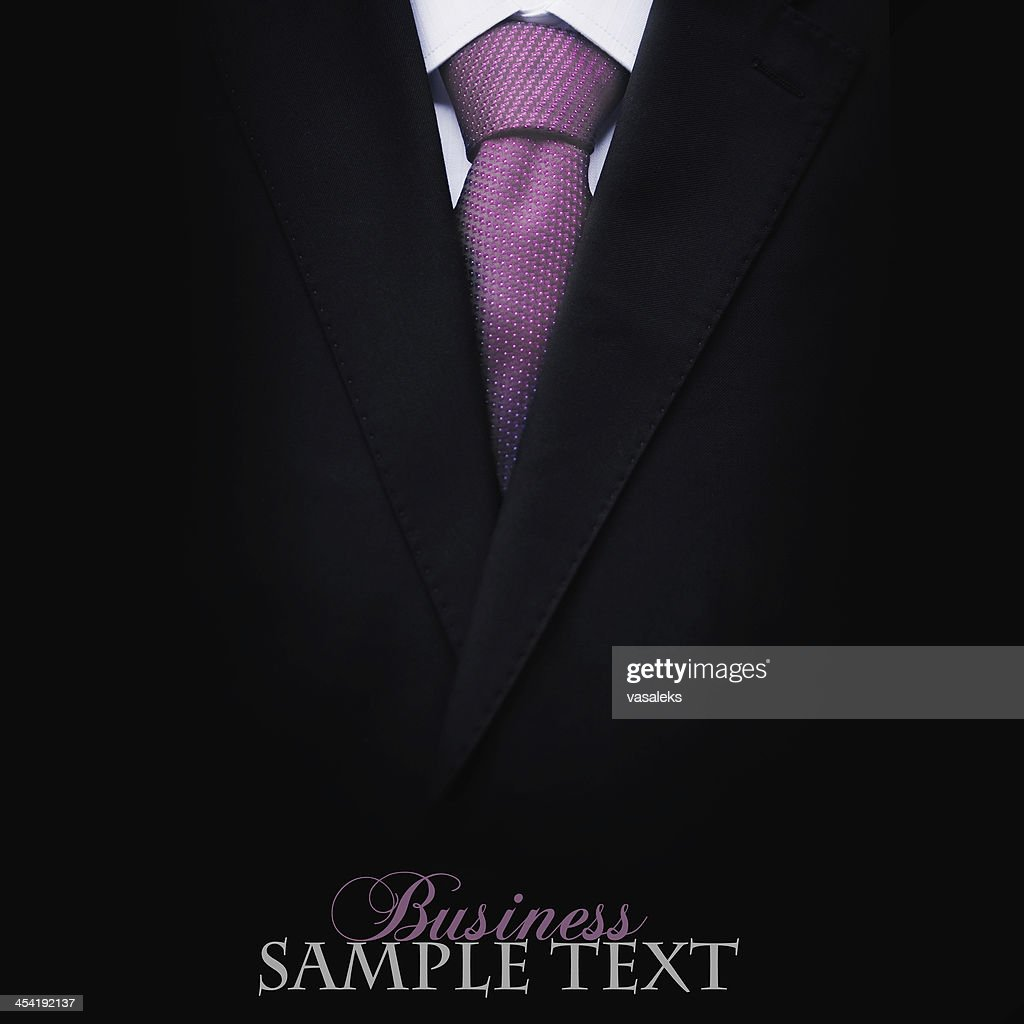 Black business suit with a tie : Stock Photo