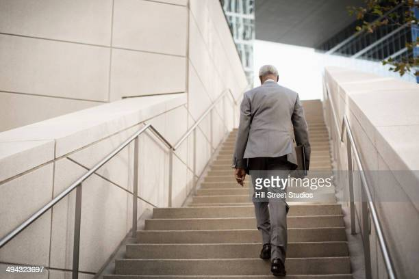 Black businessman ascending steps