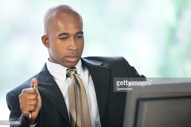 Black Businessman Looking At Computer