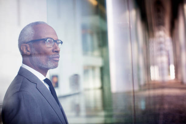 Black Businessman Looking Out Window Wall Art