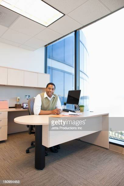 Black businessman sitting at desk