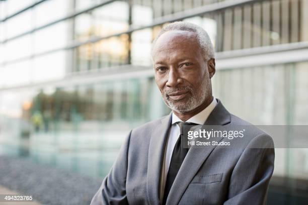 Black businessman sitting outdoors