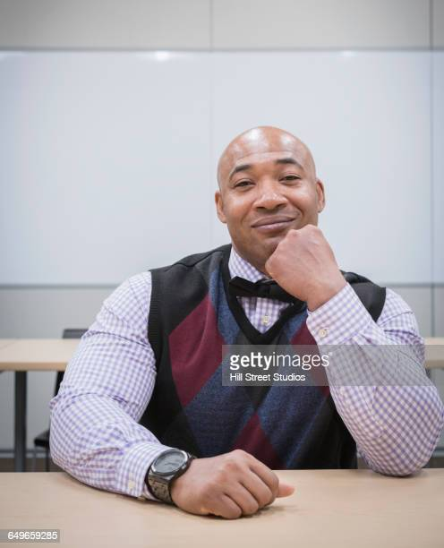 Black businessman smiling at conference table