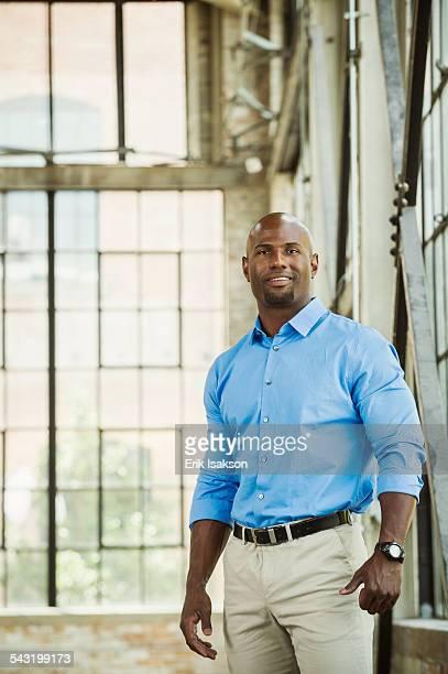 Black businessman smiling in warehouse