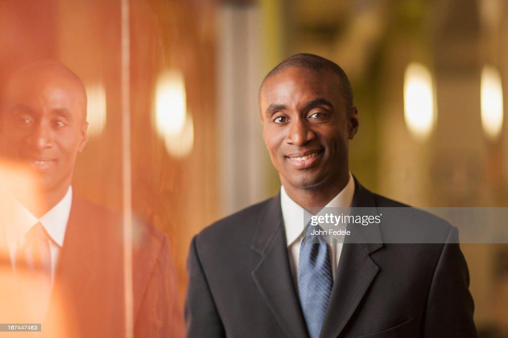 Black businessman smiling : Stock Photo