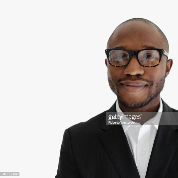 black businessman smiling - black suit stock pictures, royalty-free photos & images