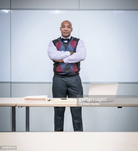 Black businessman standing in conference room