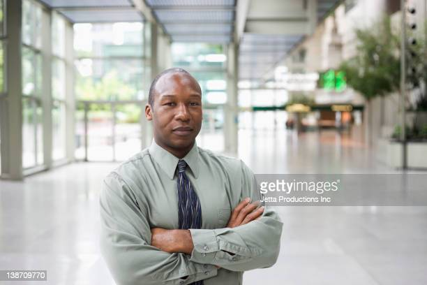 Black businessman standing in lobby