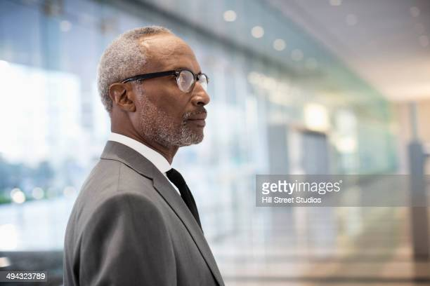 Black businessman standing in office