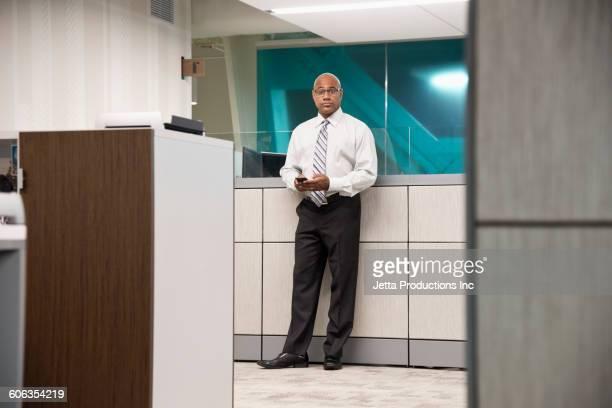 Black businessman standing in office