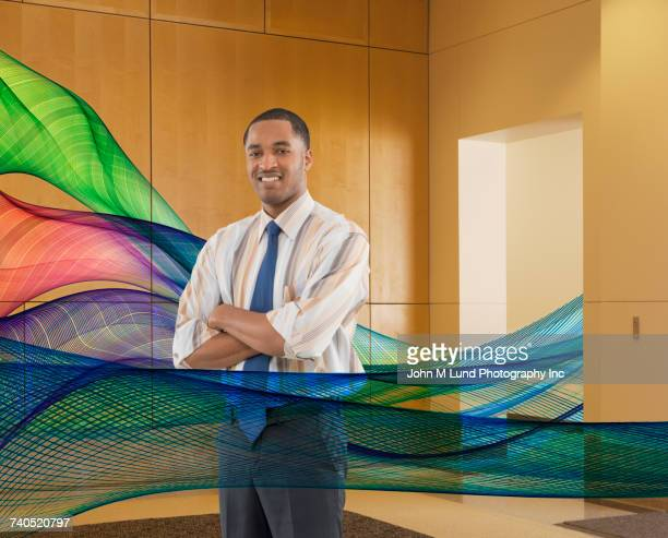 Black businessman standing in streaming data